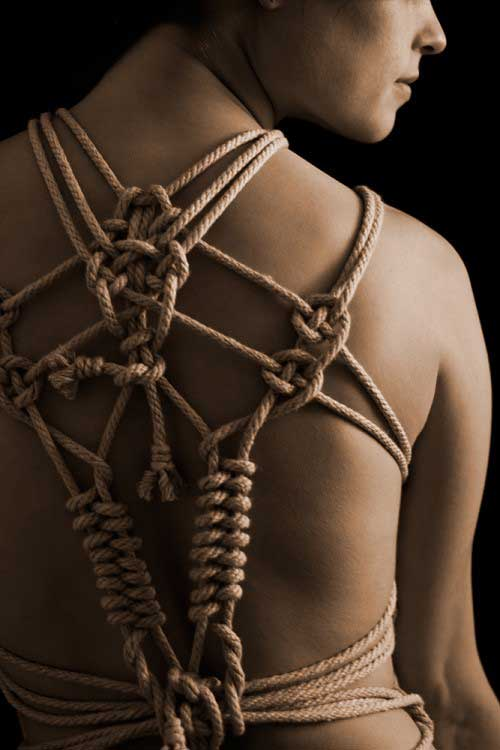 Beautiful Half-Naked Woman In Rope Restraints