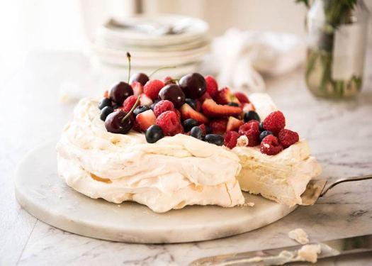 A pavlova cake with fruit