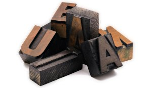 Letterpress blocks spell Adunate