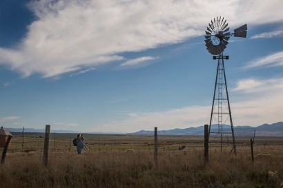 Paul Rasmussen busy photographing an old windmill on a restored farm at the Chesterfield ghost town.