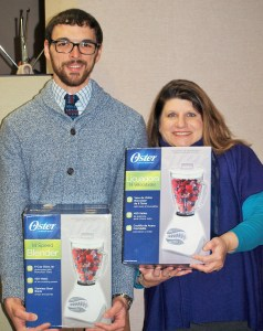 Chris Jackson, Communications Coordinator, and Char Brooks, Member of the Economic Security Team, pose with blenders donated for seniors by Sears.