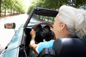 Senior driving a convertible.