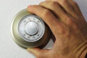 Hand adjusting thermostat.