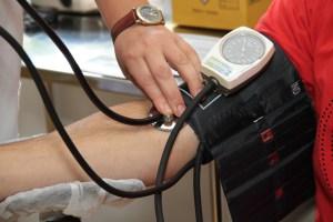 Woman having blood pressure taken.