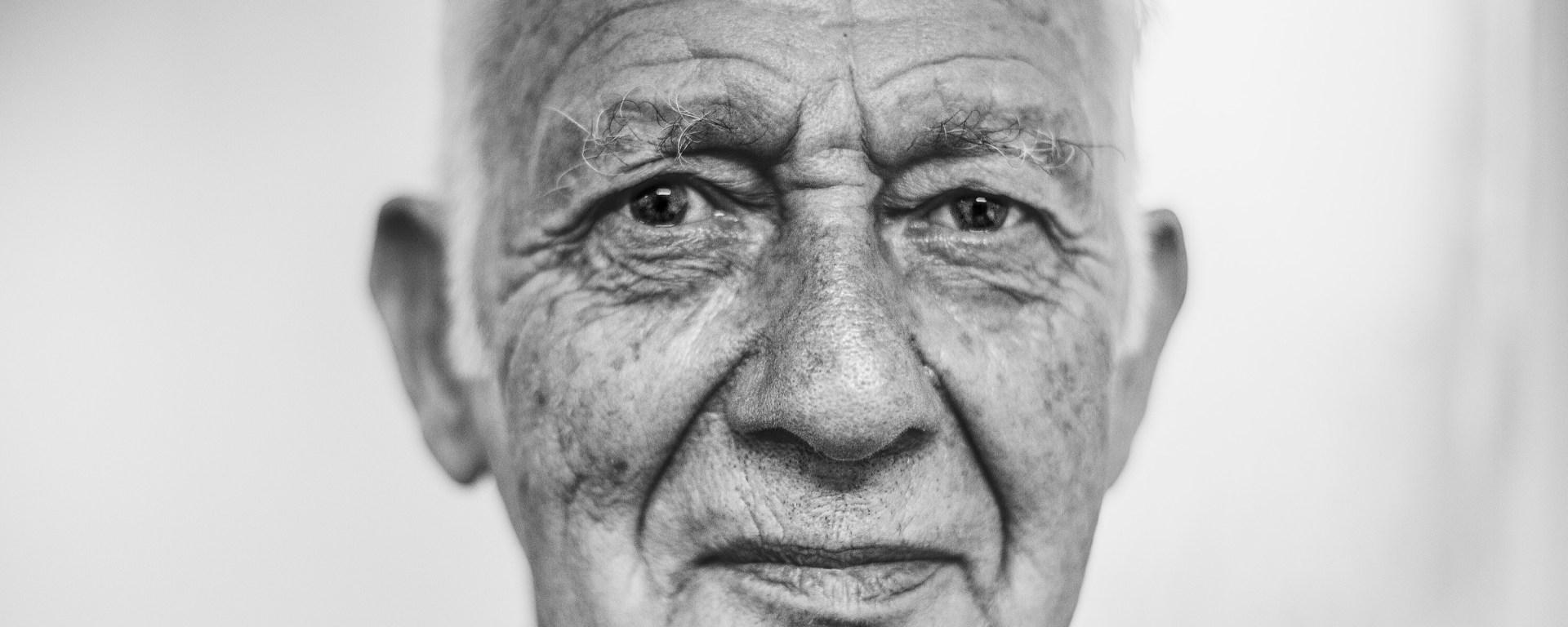 Headshot portrait of elderly man.