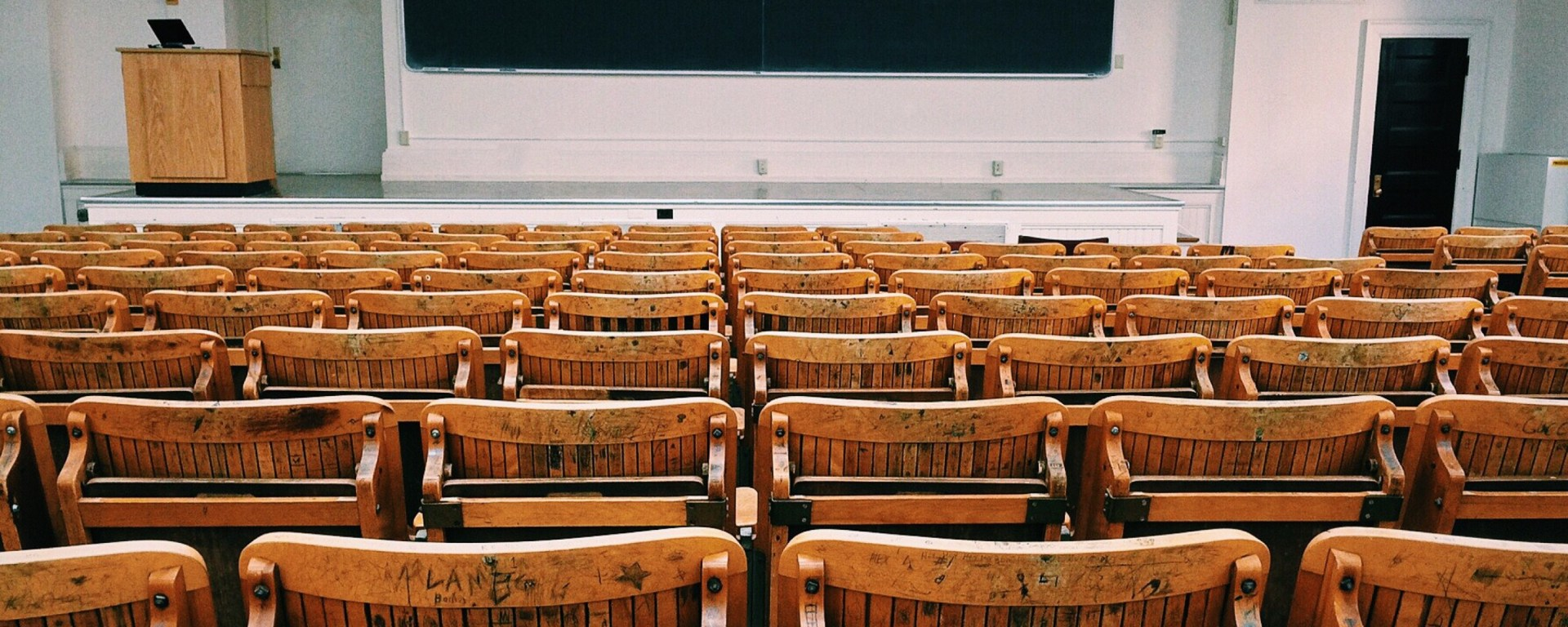 wooden chairs in a classroom
