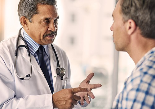 A doctor talks to his male patient.