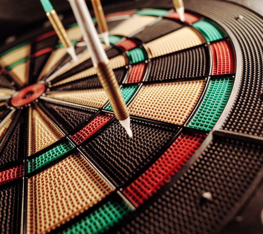 Darts on a dart board.