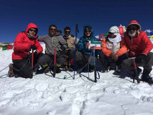 Adventure Pulse Image of Trekkers on Snow with Gears