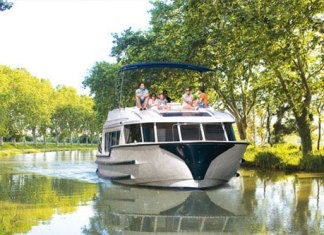 Rent boat to see canals in France and Netherlands