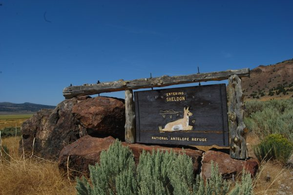 A historic sign at the entrance of the Sheldon National Wildlife Refuge