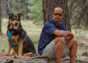 About David Rittershaus; Owner of Adventure Auto Glass with One of His Rescued Dogs