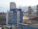 Huge murals adorn the sides of apartment blocks