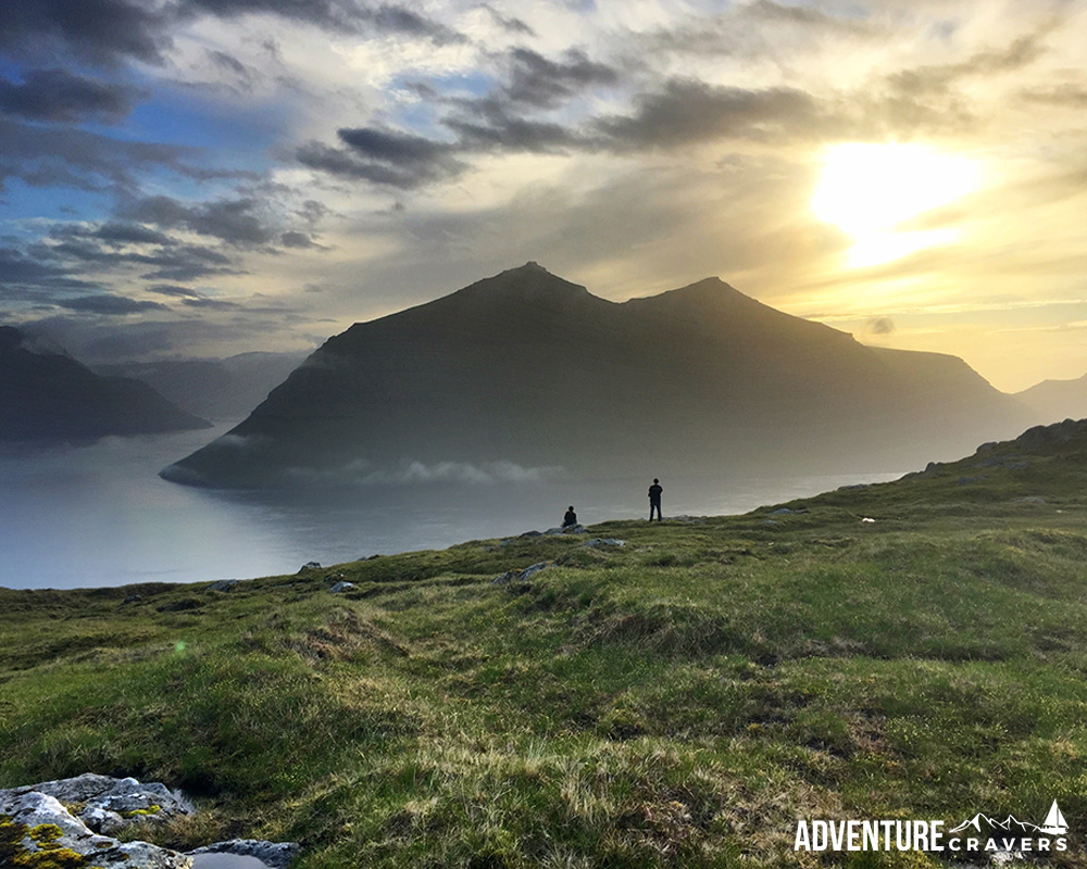 The sunset silhouette view from above Klaskvik in the Faroe Islands