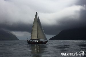 Oriole sailing through the Faroe Islands during a moody, rainy day.