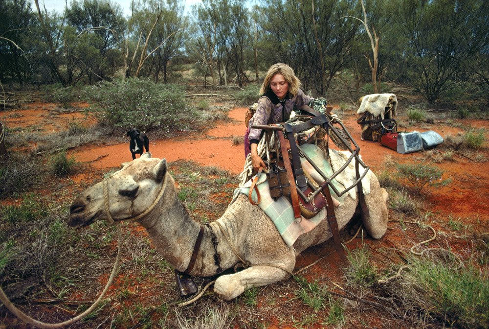 Robyn Davidson and her camels along her Australian trek. Photography by Rick Smolan/Against All Odds Production