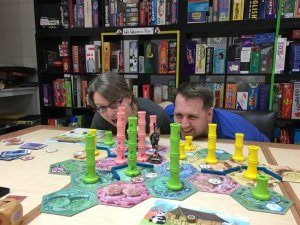 Andrea and Blair behind the giant game pieces in Giant Takenoko.