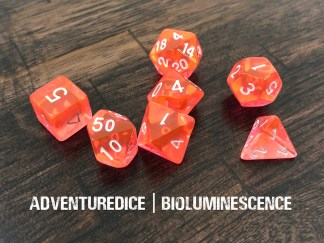 Bioluminescence dnd dice set (orange/pink dice with white numbering)