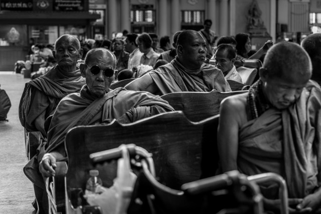 Monks waiting at a station in Bangkok