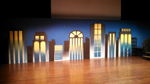 This was for a superhero-themed show that my school's clubs put on. They asked me to design a backdrop on 9 8x4 flats. So, I made a classic, comic-like city-scape!