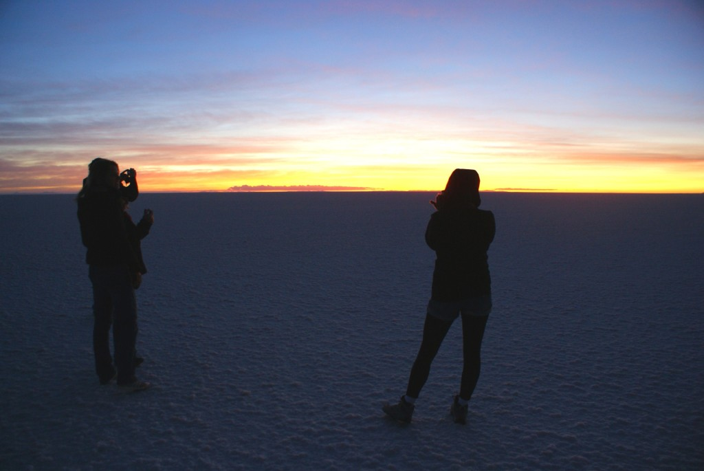 Taking pictures of the sunrise over the expansive Uyuni Salt Flats.