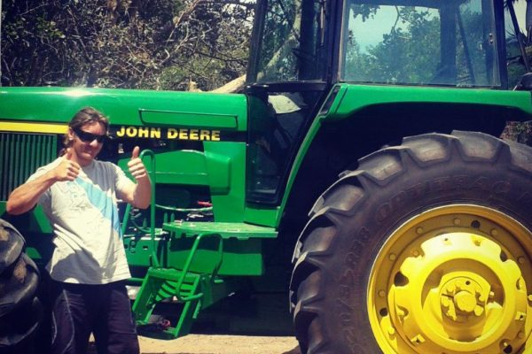 Taking a ride on the big green tractor