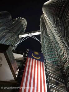 Malaysian flag on the Petronas Towers at night.