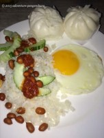 My favorite breakfast. Nasi lemak- egg, coconut rice with cucumber, peanuts, dried fish, and sambal- a red chili sauce. I like to mix it all together, but that doesn't make a pretty picture. Also mini pau dumplings, with a savory chicken filling.