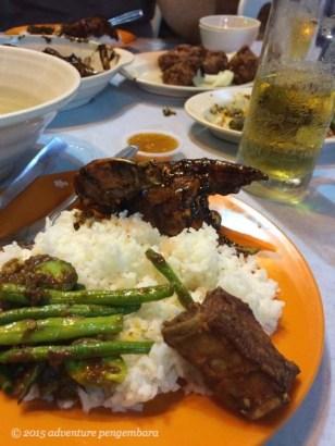 Dinner on Jalan Alor. Veggies, black pepper crab, and pork ribs. So tasty.