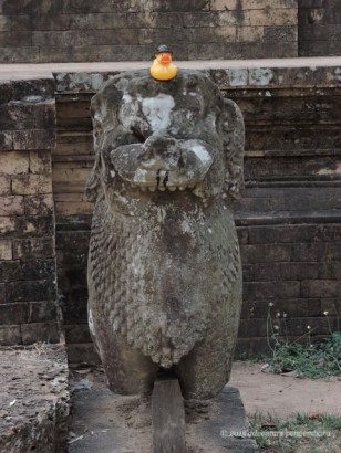 Prasat Kravan, visiting with one of the lion guardians.