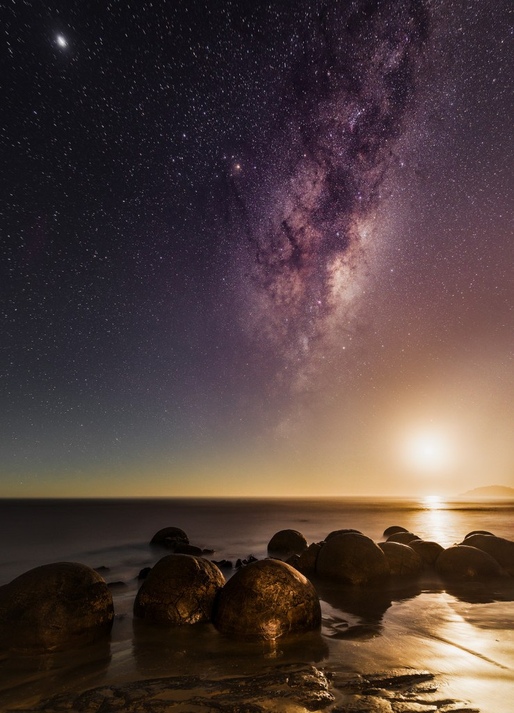 Moon rise over the Moeraki Boulders in New Zealand South Island Coast