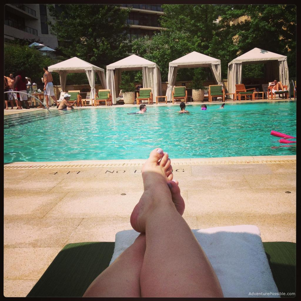 Picture of woman by pool relaxing on the day off