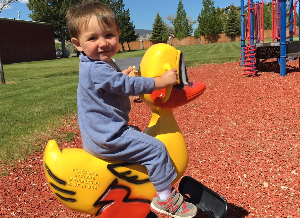 Wilson riding a duck at the playground in Capitol Reef.