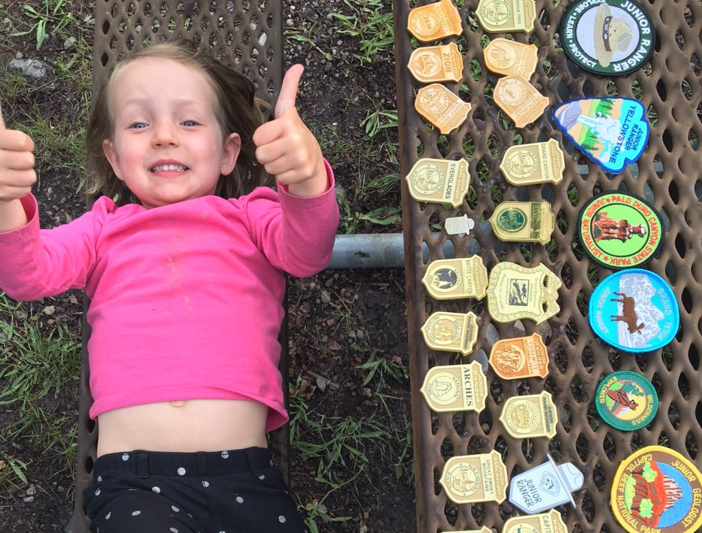Jane and her Junior Ranger badge collection to date.