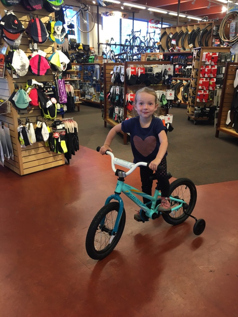 Jane with her new bike. The training wheels came off as soon as we got home.