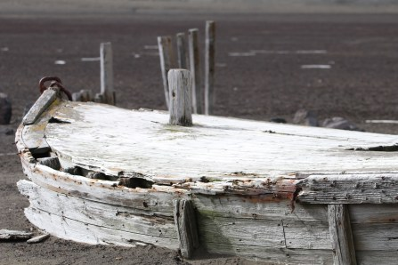 whalers boat from long ago sitting in ash