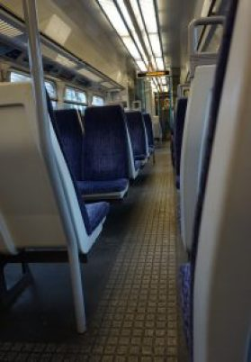 The view of an isle on an empty train.