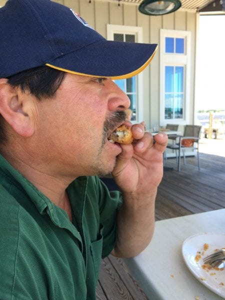 Raul eating my lunch Persimmons
