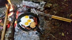 cooking breakfast over the open fire