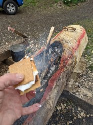 S'more cooked on dugout fire