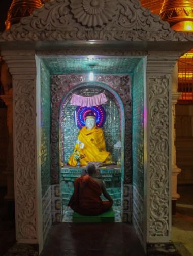 Monk worshipping in Shwedagon Pagoda, Myanmar