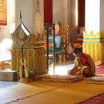 A young monk escapes the afternoon heat to contemplate scripture