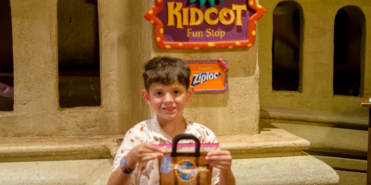 Jackson gets his Ziploc Kidcot Fun Stop bag in Mexico at Epcot World Showcase