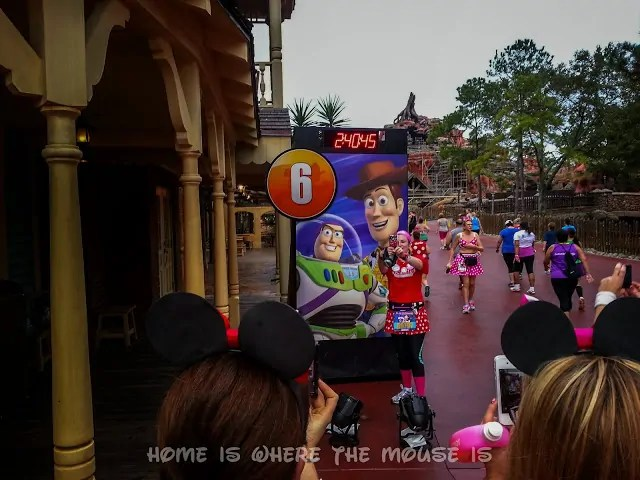 Buzz and Woody on Mile Marker 6 in Frontierland
