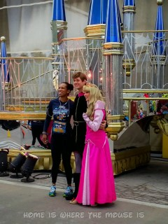 A runner poses with Sleeping Beauty and Prince Philip