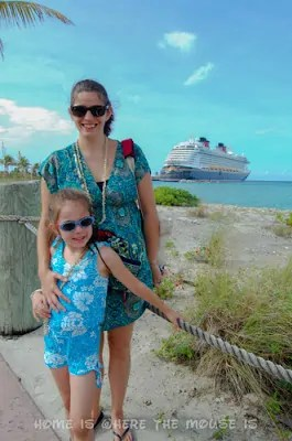 Lisa and Bella pose with Disney Dream in background at Castaway Cay