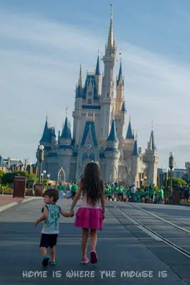 Jackson and Bella walk toward Cinderella Castle in Walt Disney World's Magic Kingdom