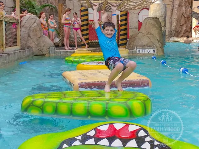 Jackson crosses the rope bridge in Aquatopia at Camelback Resort