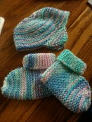 Earflap hat and booties - These were made years ago and have been in safe keeping for a special little one.