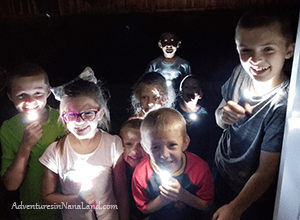 Kids playing flashlight tag, kids playing night games, grandma camp